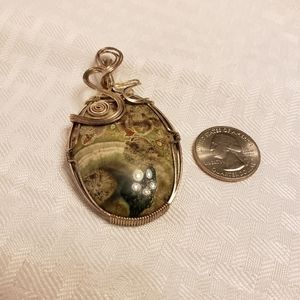 Sterling silver hand wrapped pendant